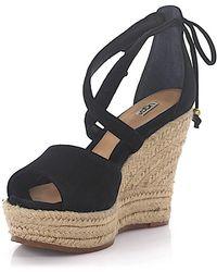 b6e74a92446 Ugg Reagan Wedge Sandals in Black | Lyst