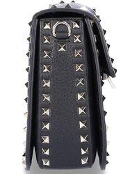 d6ee5327a1f41 Valentino - Women Handtasche B0c25 Lammnappaleder Nieten Gold Logo Schwarz  - Lyst