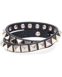 Valentino - Women Armband Rockstud Kalbleder Nieten Gold Schwarz - Lyst