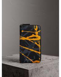 Burberry - Splash Trench Leather Ziparound Wallet - Lyst