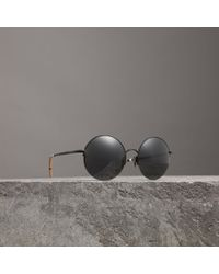 f23562fa3553 Lyst - Burberry Check Wrapped Cat Eye Sunglasses in Black