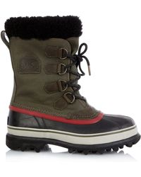 Sorel Caribou™ Canvas And Rubber Boots - Lyst