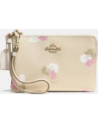 COACH | Corner Zip Wristlet In Floral Print Coated Canvas | Lyst