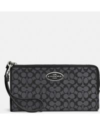 Coach Zippy Wallet In Embossed Signature Canvas - Lyst