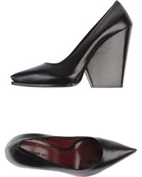Celine Wedge Pointed-Toe Pumps - Lyst