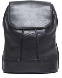Chanel Pre-Owned Black Lambskin Cc Backpack - Lyst