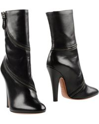 Alaïa | Chain-Trimmed Leather Ankle Boots | Lyst