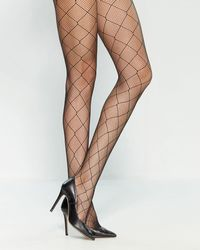 fa15620542fd7 Vince Camuto Pyramid Studded Tights in Black - Lyst