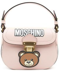 e9c3a9a6c9b0 Lyst - Moschino Teddy Bear Tab Faux Leather Tote Bag in White