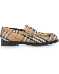 b32c2f98a32 Burberry Leather Bedmont Eyelet Detail Penny Loafers in Black - Lyst