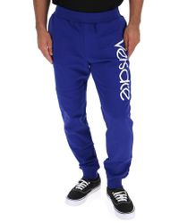 Versace - Tapered Logo-embroidered Loopback Cotton-jersey Sweatpants - Lyst