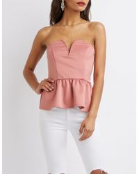Charlotte Russe - Notched Peplum Top - Lyst