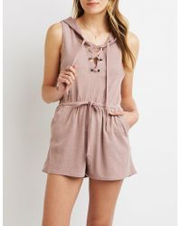 a6f76682bae Charlotte Russe - Lace-up Hoodie Romper - Lyst