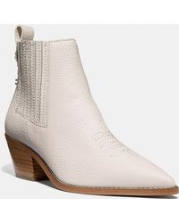 d4349f586abf Lyst - COACH Melody Suede Western Booties in Pink