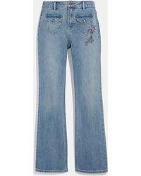 COACH - Embellished Denim Pants - Lyst