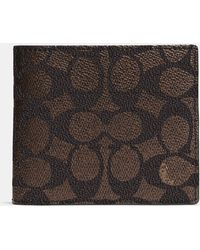 COACH - Compact Id Wallet In Signature Coated Canvas - Lyst
