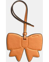 COACH - Bow Ornament - Lyst