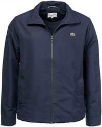 6cec0930aada Lyst - Lacoste Short Contrast Lining Quilted Jacket in Blue for Men