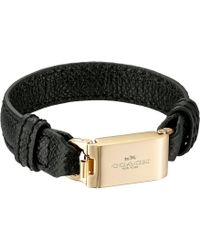 Coach Leather Horse And Carriage Id Bracelet gold - Lyst