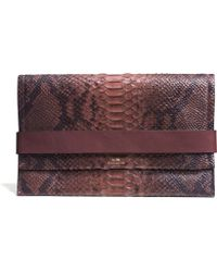 Coach Bleecker Clutch in Python Embossed Leather - Lyst