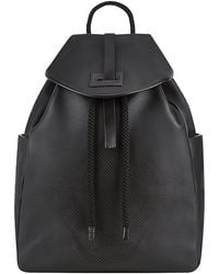 Alexander McQueen Perforated Skull Backpack - Lyst
