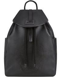 Alexander McQueen Perforated Skull Backpack black - Lyst