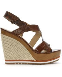 cda41f57a4ca Michael Kors - Mackay Luggage Leather Embossed Wedge Sandals - Lyst