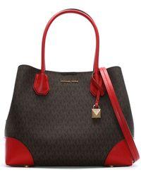 c5deb508140 Michael Kors - Annie Medium Brown   Bright Red Coated Canvas Logo Tote Bag  - Lyst