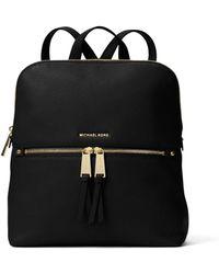 8173194ec0b9 ... amazon michael kors rhea medium slim leather backpack lyst ccd7f 82169