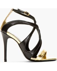 Alexander McQueen Black and Gold Leather Skinny Sandals - Lyst