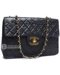 Chanel Pre-Owned Black Lambskin Maxi Single Flap Bag - Lyst