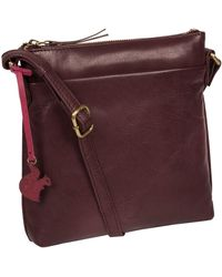 Conkca London - 'nikita' Leather Compact Cross-body Bag - Lyst