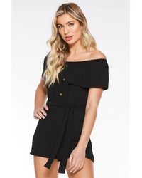 69528793a63 Quiz - Black Bardot Overlay Button Front Playsuit - Lyst