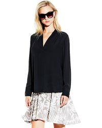 Vince Camuto V-neck Shirttail Blouse - Lyst