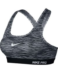 34a93583c11d5 Nike - Pro Classic Padded Reflect Printed Compression Sports Bra - Lyst