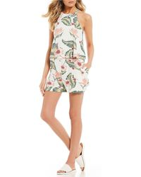 79c352b01e73 ... Women s Jumpsuit   Rompers One Piece.  45. Zappos · Roxy - Favorite Song  High Neck Tropical Print Romper - Lyst