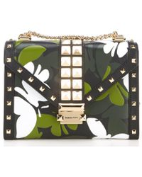 e594ac981d0f MICHAEL Michael Kors - Whitney Large Studded Butterfly Camo Shoulder Bag -  Lyst