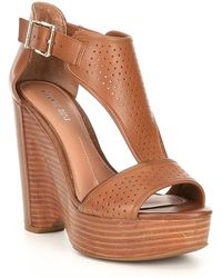 1893807836b4 Gianni Bini - Byrklee Burnished Leather Perforated Wedges - Lyst