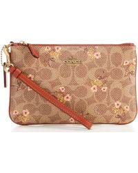 90ef27394fce9f COACH - Signature Coated Canvas Floral Bow Print Small Zip Wristlet - Lyst