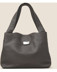 DKNY - Pebbled Leather Rock Logo Hobo - Lyst