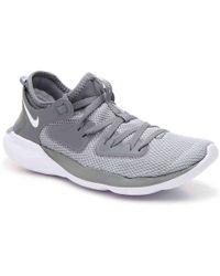 d5b6e9a83526 Lyst - Nike Flex 18 Rn Lightweight Running Shoe in White