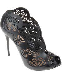 Alexander McQueen Sandalo Nero In Pelle Traforata Composizione - Lyst