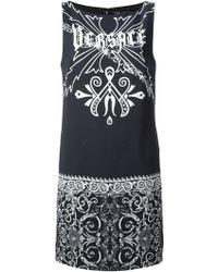 Versace Gothic Logo Dress - Lyst