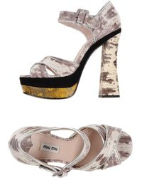 Miu Miu Sandals gray - Lyst