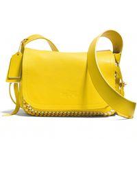 Coach Dakotah 21 Whipstitched Crossbody Bag yellow - Lyst