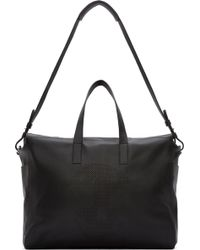 Alexander McQueen Black Perforated Skull Duffle Bag - Lyst