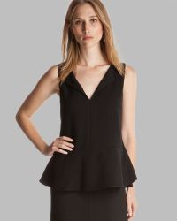 Halston Heritage Top - Sleeveless Notched Neck Peplum With Ruffle Detail - Lyst