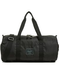 Herschel Supply Co. - Surplus Sutton Medium Duffel Bag - Lyst