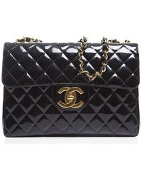 Chanel Preowned Black Patent Classic Jumbo Flap - Lyst