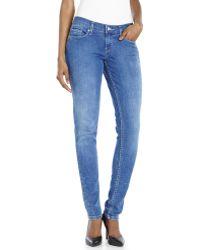 Levi's Medium Wash 524 Skinny Jeans - Lyst